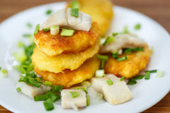 Potato pancakes with herring and onion Stock Image