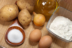 Potato pancakes ingredients. And olive oil for a frying royalty free stock photos