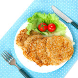 A potato pancakes with lettuce and tomatos Royalty Free Stock Image