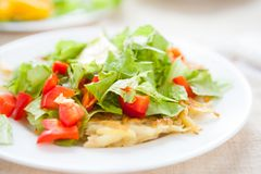 Potato pancakes with lettuce top Royalty Free Stock Image