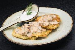 Potato pancakes with mushrooms Royalty Free Stock Images