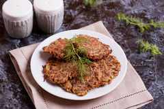Potato pancakes on plate with dill royalty free stock photos