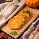 Potato pancakes with pumpkin puree Stock Photos