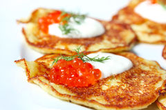 Potato pancakes with red caviar Stock Photo