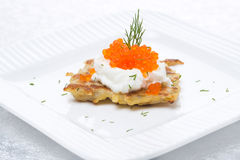 Potato pancakes with red caviar Stock Photos