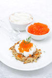 Potato pancakes with red caviar, vertical Royalty Free Stock Image