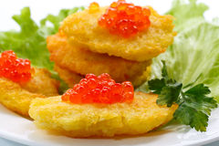 Potato pancakes with red caviar Stock Photography