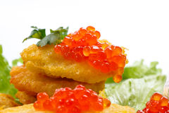 Potato pancakes with red caviar Royalty Free Stock Photos