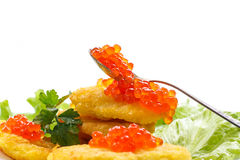 Potato pancakes with red caviar Stock Image