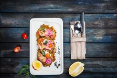Potato pancakes with salmon and cream cheese Royalty Free Stock Images