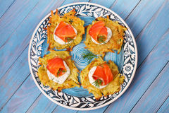 Potato Pancakes With Salmon. Vegetable fritters with fish. Latkes on a plate. Royalty Free Stock Photography