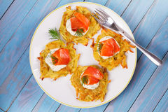 Potato Pancakes With Salmon. Vegetable fritters with fish. Latkes on a plate. Stock Photo