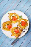 Potato Pancakes With Salmon. Vegetable fritters with fish. Latkes on a plate. Royalty Free Stock Photos