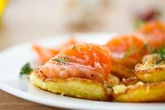 Potato pancakes with salted salmon Royalty Free Stock Photo
