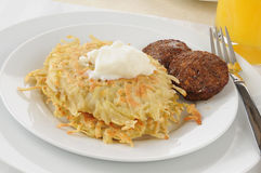 Potato pancakes with sausage Royalty Free Stock Photos