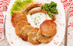 Potato pancakes with sausage Royalty Free Stock Image