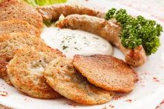 Potato pancakes with sausage stock photos