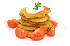 Potato pancakes with slices of tomato on a plate Stock Photo