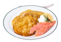 Potato pancakes with smoked salmon and cheese cream Royalty Free Stock Photos