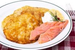 Potato pancakes with smoked salmon and cheese cream Stock Photos