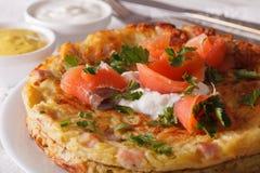 Potato pancakes with smoked salmon on a plate close-up. horizont Stock Image