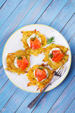 Potato Pancakes With Smoked Salmon. Vegetable fritters with fish. Latkes on a plate. Royalty Free Stock Photography