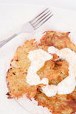 Potato Pancakes. With some cream and brown sugar Stock Photo