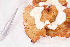 Potato Pancakes. With some cream and brown sugar Stock Photography