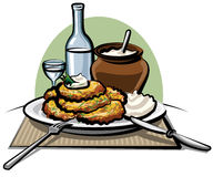 Potato pancakes with sour cream. And vodka Royalty Free Stock Photography