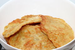 Potato pancakes. With sour cream with carrot. Preparation of meals Royalty Free Stock Photos