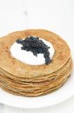 Potato pancakes with sour cream and caviar selective focus stock photo