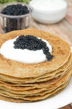 Potato pancakes with sour cream and caviar selective focus Royalty Free Stock Photo