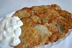 Potato pancakes with sour cream Royalty Free Stock Photography