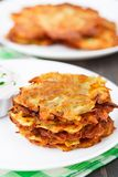 Potato pancakes with sour cream Royalty Free Stock Photos