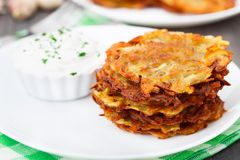 Potato pancakes with sour cream Stock Image
