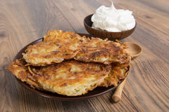 Potato pancakes with sour cream Royalty Free Stock Images