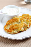 Potato pancakes with sour cream Royalty Free Stock Image