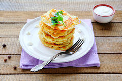 Potato pancakes with sour cream Stock Photos