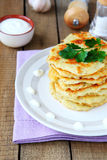 Potato pancakes with sour cream Stock Photo
