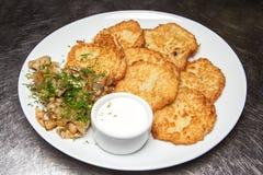 Potato pancakes with sour cream Royalty Free Stock Photography