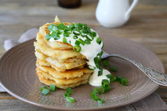 Potato pancakes with sour cream and green onions Royalty Free Stock Photo