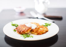 Potato pancakes with sour cream and green onions Stock Photo