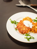 Potato pancakes with sour cream and green onions Royalty Free Stock Image