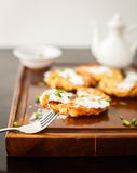 Potato pancakes with sour cream and green onions Stock Photography