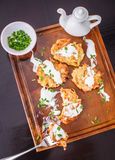 Potato pancakes with sour cream and green onions Royalty Free Stock Photography