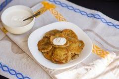 Potato pancakes with sour cream Stock Photography