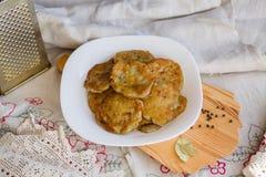 Potato pancakes with sour cream Stock Photos