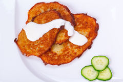 Potato pancakes with sour cream Royalty Free Stock Photo