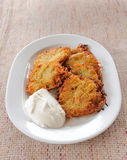 Potato pancakes with sour cream on a plate Royalty Free Stock Image