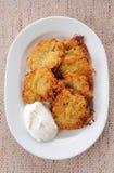 Potato pancakes with sour cream on a plate Royalty Free Stock Photos